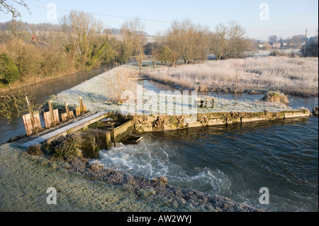 A frosty winter morning view of a mill pool on the River Avon in Wiltshire - Stock Photo