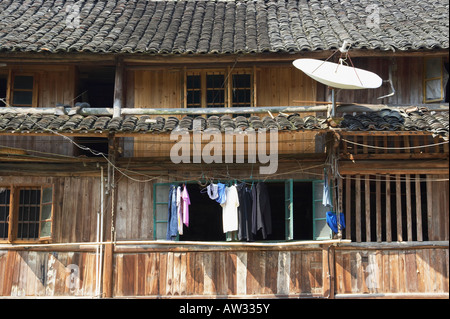 Satellite Dish On Roof Of Traditional Wooden House, Chenyang, Guangxi - Stock Photo
