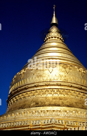 Golden stupa of the 11th century Shwezigon Pagoda at the ancient ruins of Bagan Burma Myanmar - Stock Photo