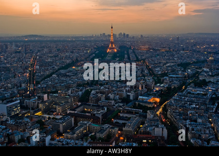 Grand view of the illuminated Paris cityscape at dusk. - Stock Photo