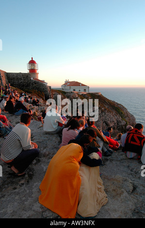 Tourists watching sunset from Cape St. Vincent or Cabo de Sao Vicente on the so-called Costa Vicentina in Algarve, - Stock Photo