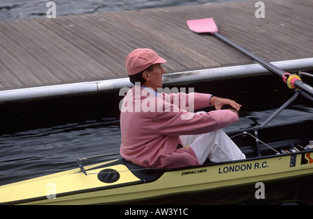 Cox of the Leander Club sitting in stern of rowing boat at Henley Royal Regatta, Henley, River Thames, Oxfordshire, - Stock Photo