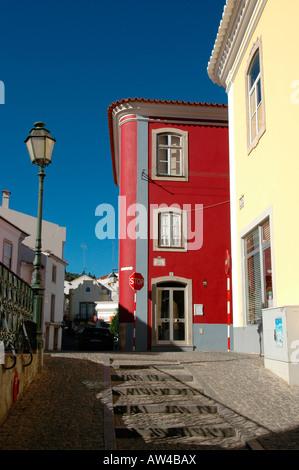 The cobbled street leading uphill toward Convento Nossa Senhora De Desterro monastery in the town of Monchique in - Stock Photo