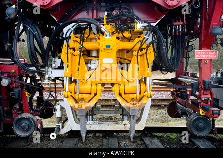 mechanical tamp plasser theurer railway track tamping machine stock photo