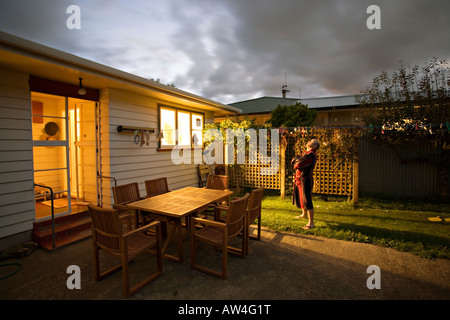 At home in the night man watching the stars - Stock Photo