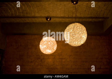 two light balls in a dark room - Stock Photo