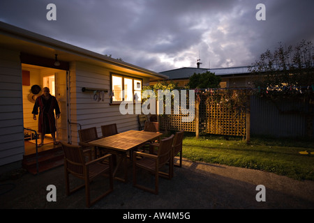 Night home man standing in doorway - Stock Photo