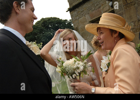 A couple outside the church after getting married Model Released - Stock Photo