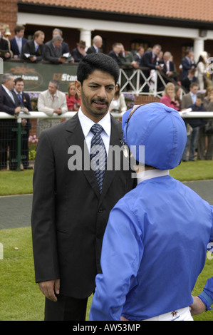 Godolphin trainer Saeed bin Suroor talking to jockey Frankie Dettori - Stock Photo