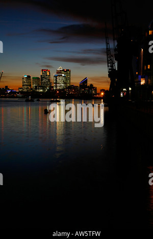 Canary Wharf seen from Royal Victoria Dock, Docklands, London - Stock Photo