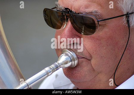 Close up of a tuba player in a brass band - Stock Photo