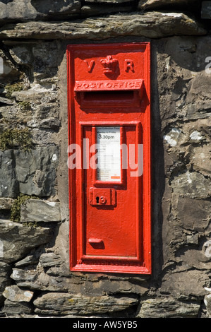 British Red Victorian  post box inset in a stone wall - Stock Photo