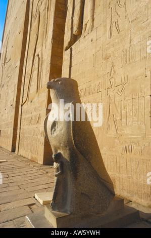 Granite statue of  the falcon god Horus in the inner temple of The temple of Horus, Edfu, Egypt Stock Photo