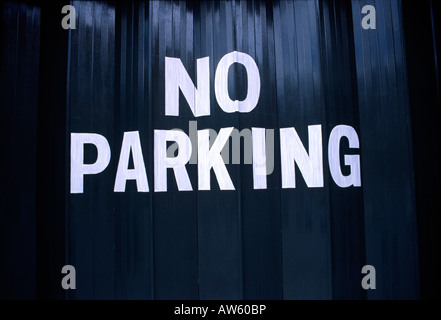 no parking sign on a garage door in the uk - Stock Photo