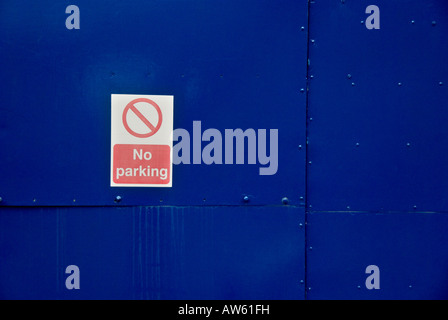 no parking sign on a blue door in hay on wye - Stock Photo