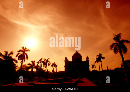India Delhi silhouette of Safterjangs Tomb at sunset - Stock Photo