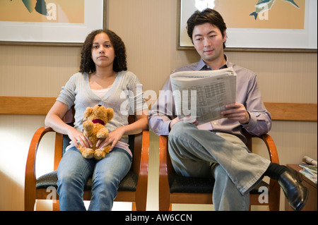 People in medical dental waiting room - Stock Photo