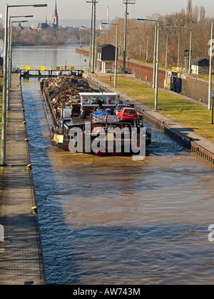 collecting old used metal iron reusable material transport of discarded metall for recycling with a barge on the - Stock Photo