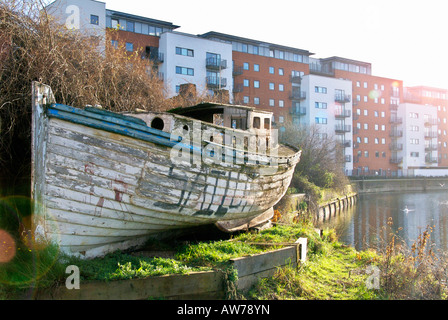 Old boat on City Mill River - Stock Photo