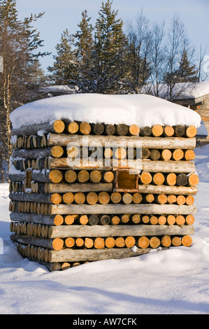 A log pile at a hotel in Kakslauttanen near Saarisleka Northern Finland - Stock Photo