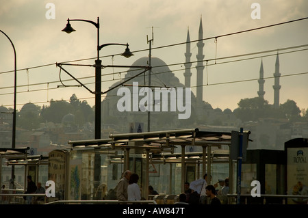 View of the Suleymaniye Camii mosque on one of the Seven Hills with a tram stop on the Galata Bridge in the foreground - Stock Photo
