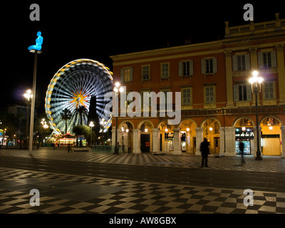 Colours light up Place Masséna in Nice, France at night. - Stock Photo
