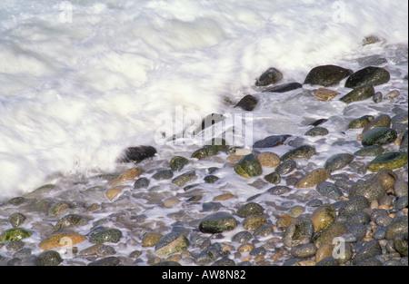 White surf on pebble beach Big Sur Coast California - Stock Photo