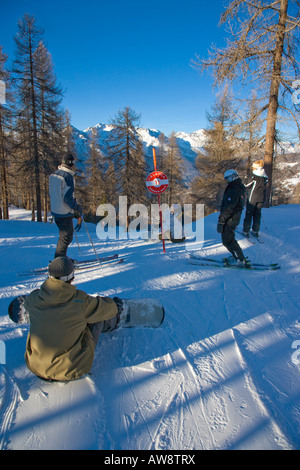 Via Lattea piste marker and skiiers Sportinia Sauze d Oulx Italy - Stock Photo