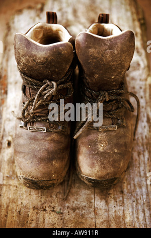 Aged, worn and battered walking boots - Stock Photo