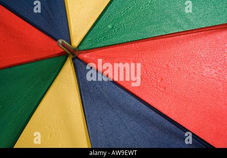 Umbrella with raindrops on it. - Stock Photo