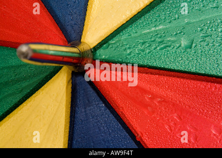 Close up of an umbrella with raindrops on it. - Stock Photo