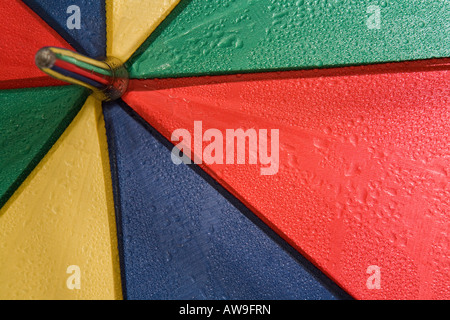 Close up of an umbrella with rain drops on it. - Stock Photo