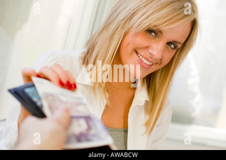 Teenager accepting money - Stock Photo