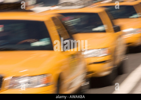 Three taxi cabs on street in New York NY - Stock Photo