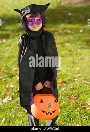 Portrait of boy in Halloween costume - Stock Photo