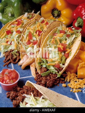 assortment three hard shell tacos beef chicken steak cheese lettuce tomato tomatoe one soft taco salsa - Stock Photo