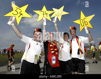 German fans hold up stars on the streets during the 2006 World Cup