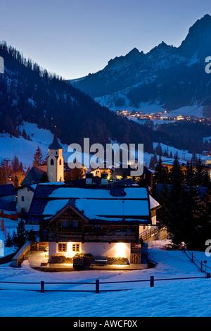 Village of Corvara at night in winter snow ,Dolomites , Italy. - Stock Photo