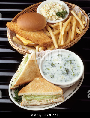 fried fish fillet sandwich roll cheese cole slaw french fry fries tuna salad sandwiches cream broccoli soup basket - Stock Photo