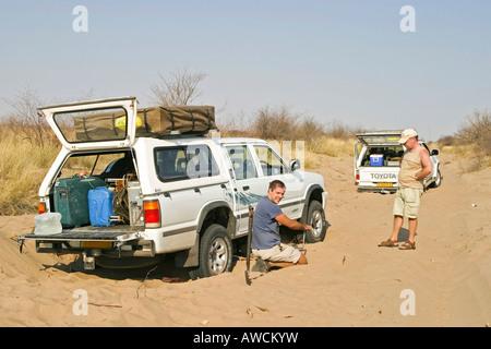 Broken 4x4 in deep Sand on the way to the Centralkalahari, Botswana, Africa - Stock Photo