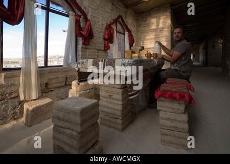 Tourist at salt hotel Marith en Atulcha, Altiplano, Bolivia, South America - Stock Photo