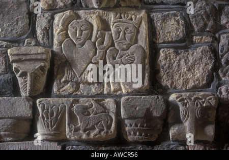 Saxon carving in wall of St. Mary's church, Wirksworth, Derbyshire, near  the Peak District National Park - Stock Photo