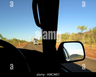 Meeting a road train on the road. - Stock Photo