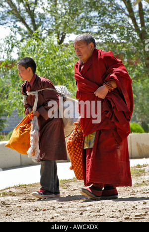 Young and old Buddhist monks, Gyantse, Tibet - Stock Photo