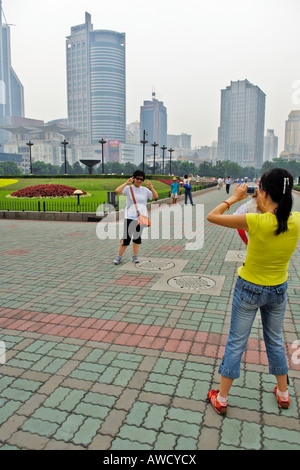 Public park, skyscrapers, chinese take some photos, Shanghai, China, Asia - Stock Photo