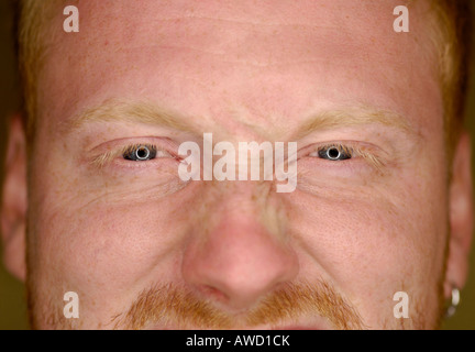 Redheaded young man's face - Stock Photo