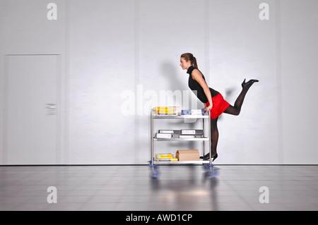 Secretary taking care of urgent documents - Stock Photo