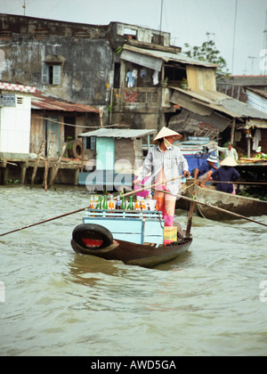 Woman Rowing A Boat Loaded With Drinks - Stock Photo