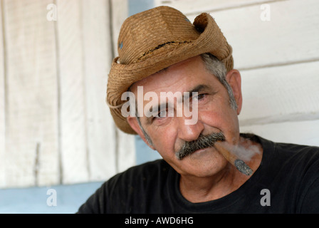Man wearing hat smoking a cigar in Vinales, Pinar del Rio, Cuba, Americas - Stock Photo
