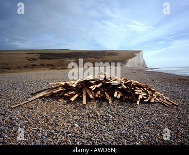 Pile of driftwood on a beach. Cuckmere Haven, East Sussex, England, UK. - Stock Photo